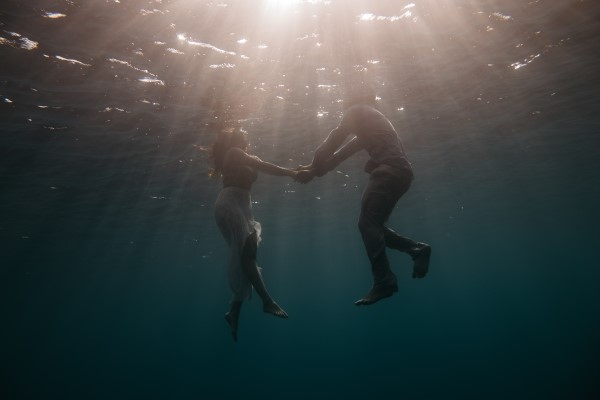 Couple underwater.